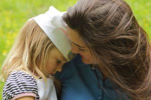 inner_orphans_woman_comforting_little_girl